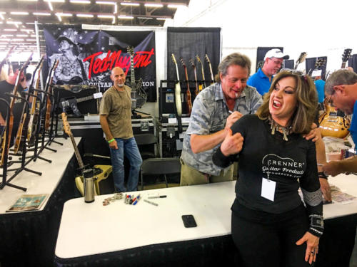 Ted Nugent signs girls back
