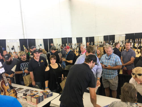 Toby Nugent working dallas guitar show