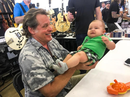 Ted Nugent with baby at guitar show